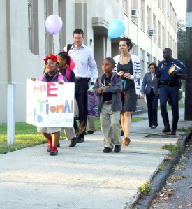 Siblings Darriella Watson, 6, and Derrick Watson, 7, lead a walking group on Pauline Street to ARISE Academy for International Walk to School Day Wednesday morning. Others in the group, from left to right, included ARISE Principal Andrew Schahan, second-grade teacher Kathleen Stevens, New Orleans Health Commissioner Karen DeSalvo and State Police Trooper Mark Jackson.